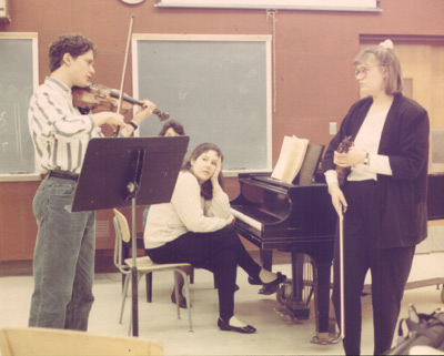 Cory Cerovsek demonstrates to Emily Greene during a master class