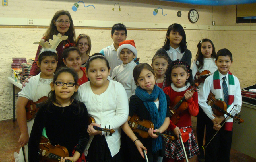 Katie Brooks with her class at Escuela Vieau for their holiday concert.